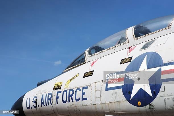 Jet fighter cockpit against sky