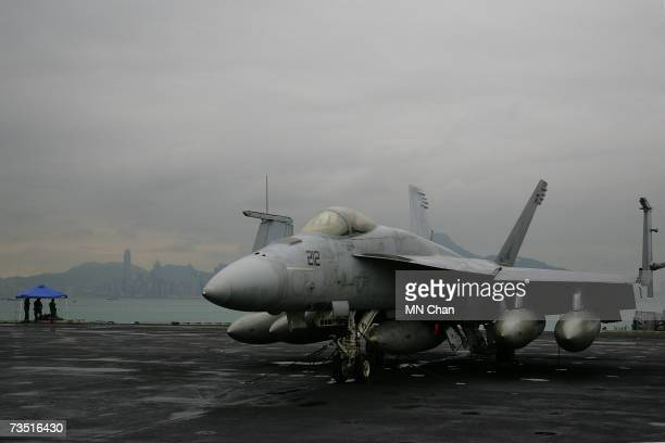 A jet fighter sits on the deck of the USS Ronald Reagan on the ship's second visit to port March 7 2007 at Victoria Harbour in Hong Kong China The...