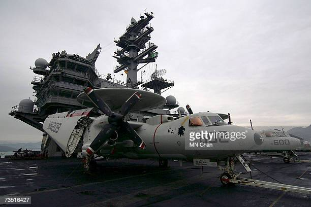 Jet fighters sit on the deck of the USS Ronald Reagan on the ship's second visit to port March 7 2007 at Victoria Harbour in Hong Kong China The ship...