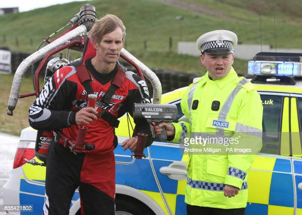 Jet pack pilot Eric Scott from Texas with traffic police officer James Henry after an attempt to set a world speed for the fastest ever jetpack...