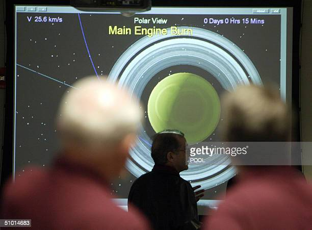 Jet Propulsion Laboratory Director Charles Elachi and others in mission control watch as the CassiniHuygens spacecraft prepares to complete the orbit...
