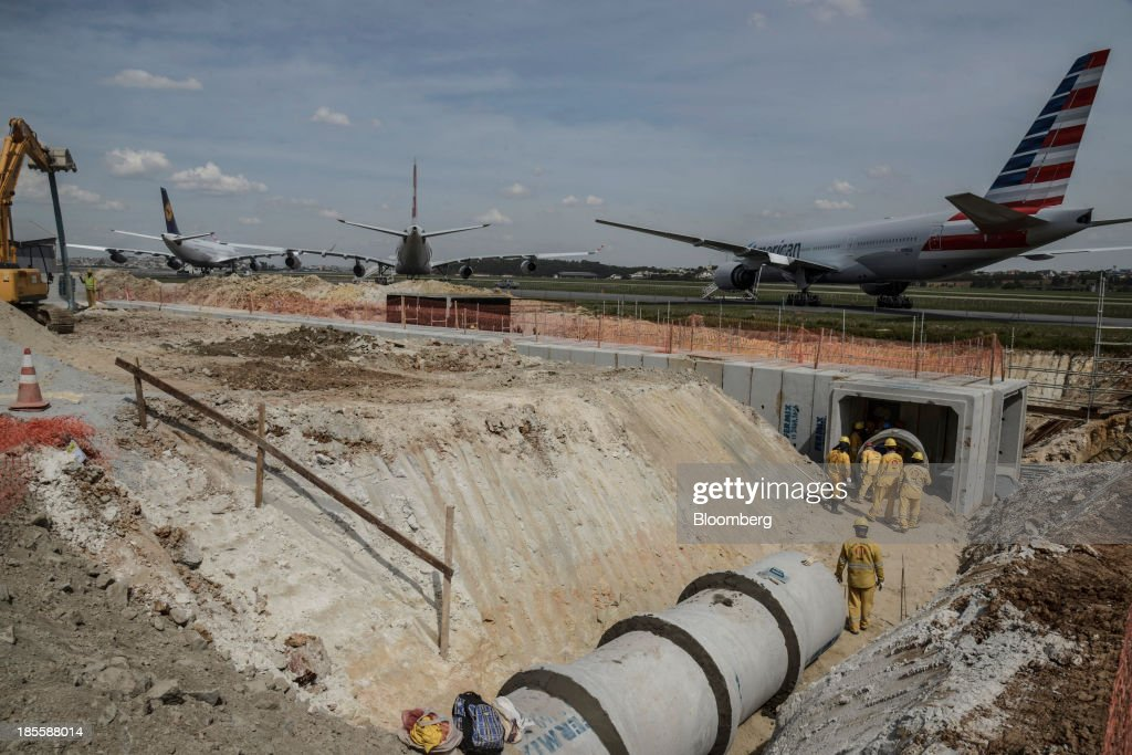 A jet sits on the tarmac nearby as construction continues on Terminals 3 and 4 at the Sao Paulo/Guarulhos Governor Andre Franco Montoro International...