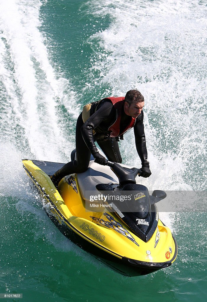 A jet skier enjoys himself in the warm weather off the coast of Brighton on May 7, 2008 in Brighton, England.