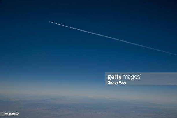 A jet streaks across the blue sky as viewed following takeoff from Santa Barbara Airport on April 12 in Santa Barbara California An unusally wet...
