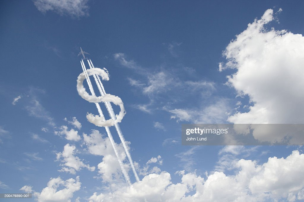 Jet trail creating dollar sign : Stock Photo