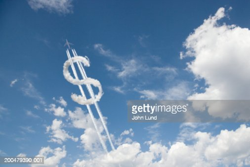 Jet trail creating dollar sign : Stockfoto