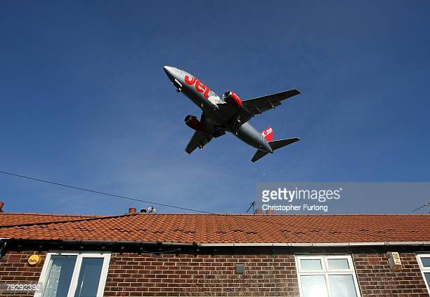Jet2 passenger aircraft landing at Manchester International Airport approaches the runway on 28 January Manchester England Baggage handlers at the...
