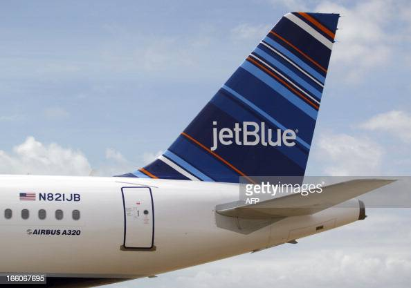 A JetBlue A320 is parked at Brookley Field after a ground breaking ceremony for an assembly line for the Airbus A320 at Brookley Aeroplex in Mobile...