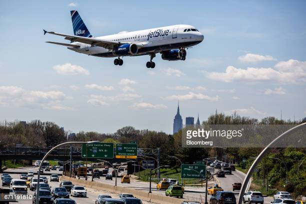 A JetBlue Airways Corp plane prepares for landing at LaGuardia Airport in New York US on Tuesday April 18 2017 An additional section of land could be...