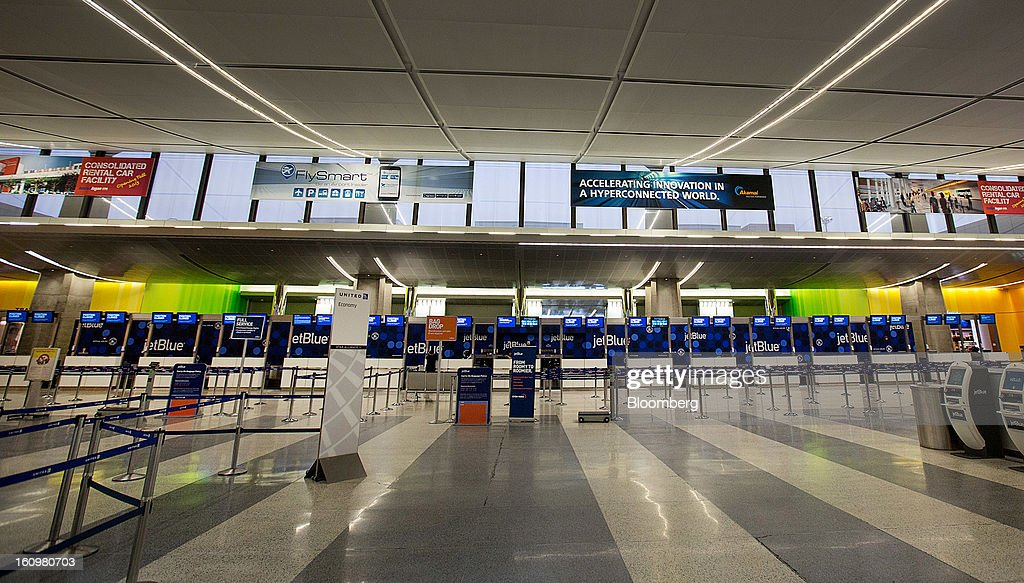 JetBlue Airways Corp. ticket counters stand empty in Terminal B at Boston Logan International Airport in Boston, Massachusetts, U.S., on Friday, Feb. 8, 2013. The New England cities are expected to receive more than 2 feet of snow by the time Winter Storm Nemo moves out tomorrow night, according to the weather service. Photographer: Scott Eisen/Bloomberg via Getty Images