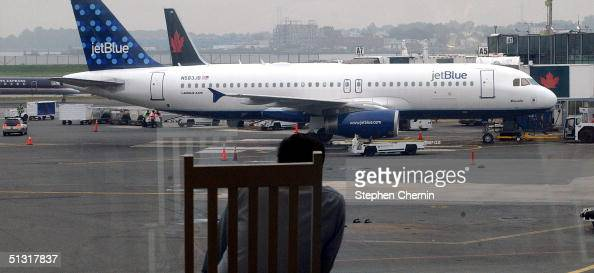 JetBlue Airways jet rests at it's gate awaiting passengers at LaGuardia Airport September 17 2004 in New York City JetBlue Airways New York's lowfare...