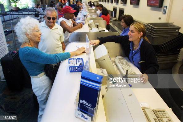 JetBlue Airways station supervisor Alison Wong right issues a plane ticket June 19 2001 at the Ft Lauderdale/Hollywood International airport in Ft...