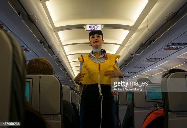 JetBlue Airways stewardess demonstrates a life vest October 17 2014 before takeoff in San Francisco California
