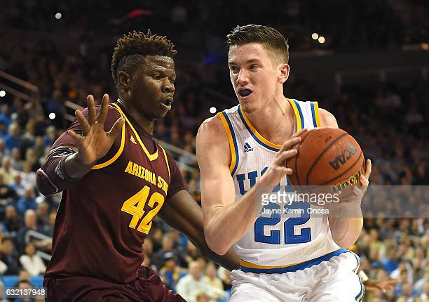 Jethro Tshisumpa of the Arizona State Sun Devils guards TJ Leaf of the UCLA Bruins as he drives to the basket in the first half of the game at Pauley...