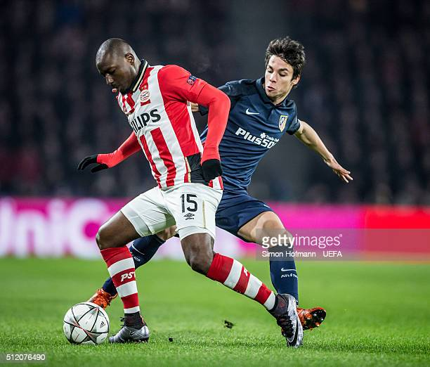 Jetro Willems of Eindhoven is challenged by Oliver Torres of Madrid during the UEFA Champions League Round of 16 First Leg match between PSV...