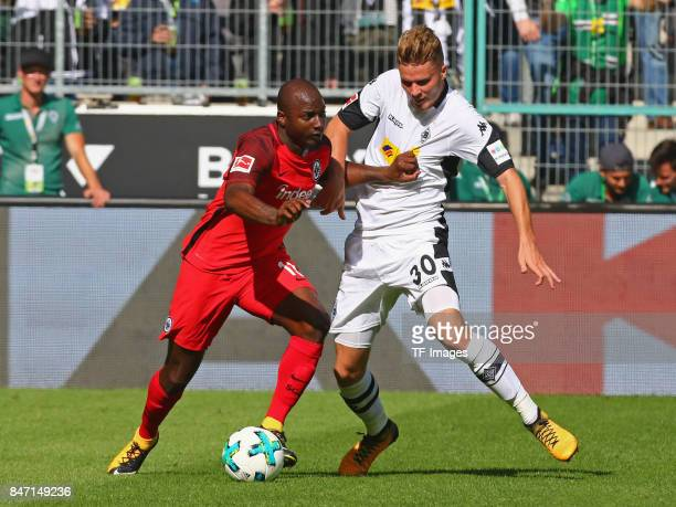 Jetro Willems of Frankfurt and Nico Elvedi of Moenchengladbach battle for the ball during the Bundesliga match between Borussia Moenchengladbach and...