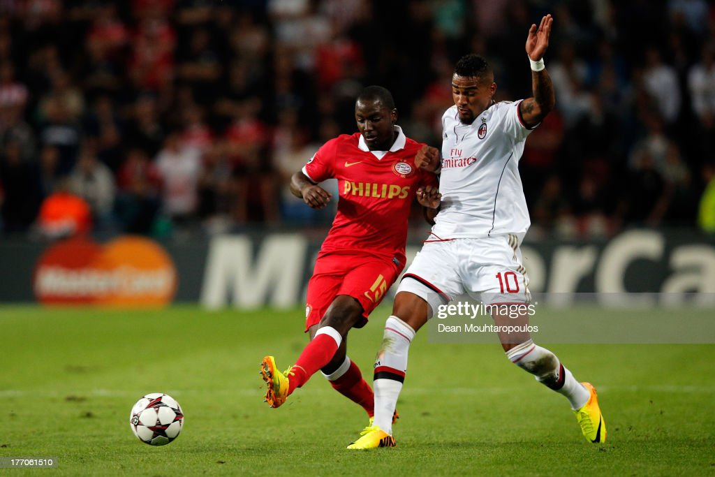 Jetro Willems of PSV and Kevin-Prince Boateng of AC Milan battle for the ball during the UEFA Champions League Play-off First Leg match between PSV Eindhoven v AC Milan at PSV Stadion on August 20, 2013 in Eindhoven, Netherlands.