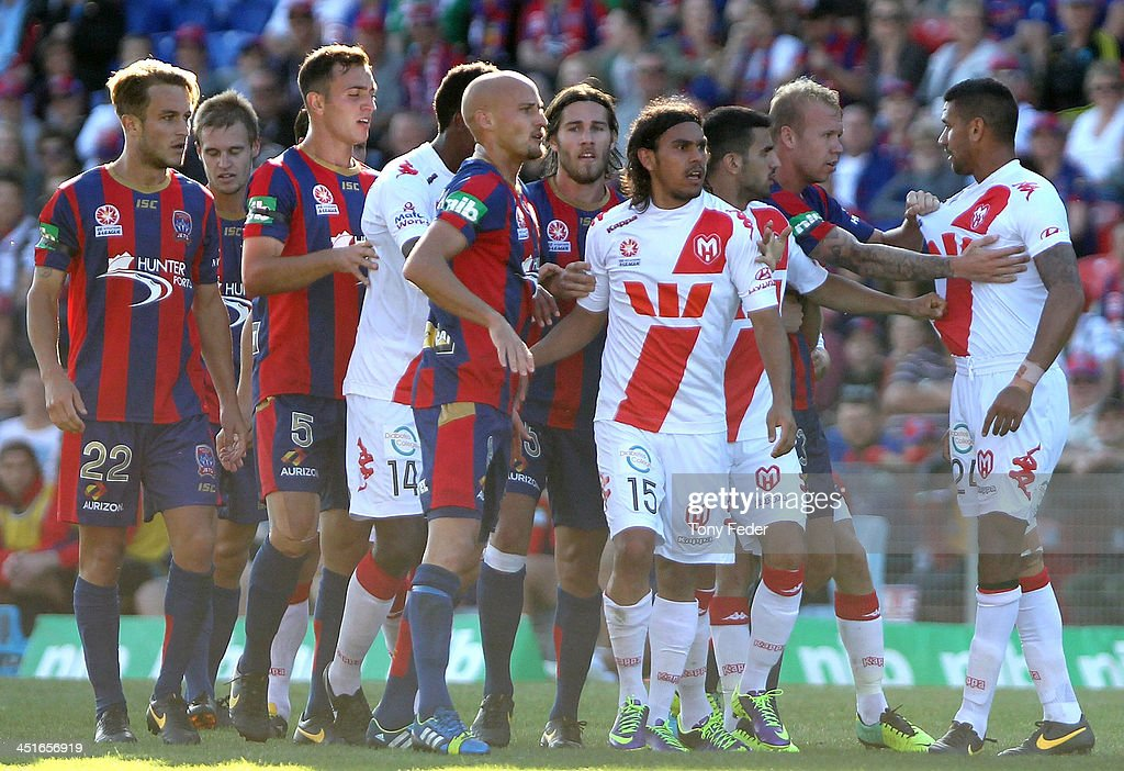 Jets and Heart players in a scuffle during the round seven A-League match between the Newcastle Jets and the Melbourne Heart at Hunter Stadium on November 24, 2013 in Newcastle, Australia.