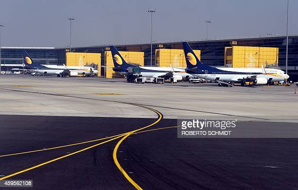 Jets belonging to the Indian airline Jet Airways are docked to a concourse at the Indira Gandhi International airport in New Delhi on November 25...