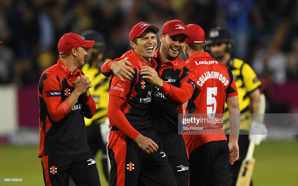 Jets fielder Gordon Muchall is congratulated by Ryan Pringle after running out Gloucestershire batsman Tom Smith during the NatWest T20 Blast...