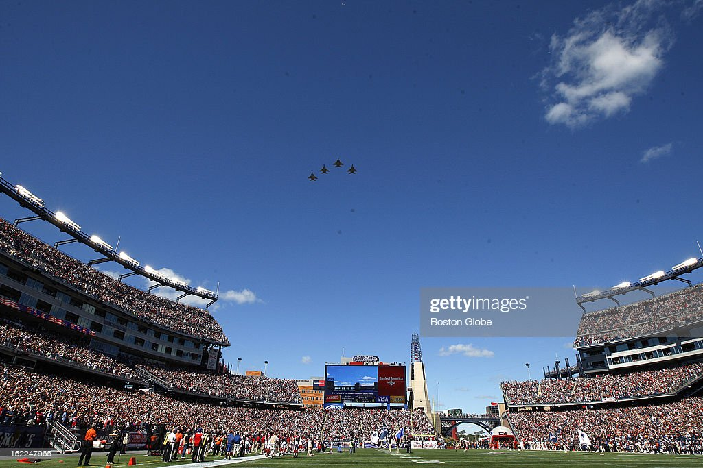 Jets fly over Gillette stadium at the end of the singing of the national anthem before the New England Patriots play the Arizona Cardinals in the...