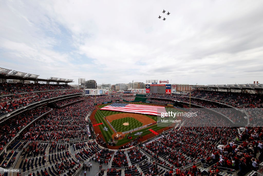 Jets fly over the stadium as the Miami Marlins and Washington Nationals line the field during the national anthem prior to the opening day game at Nationals Park on April 3, 2017 in Washington, DC.