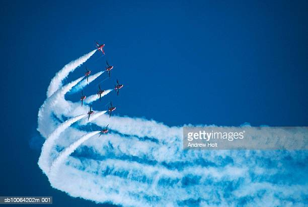 Jets flying in formation leaving smoke trail
