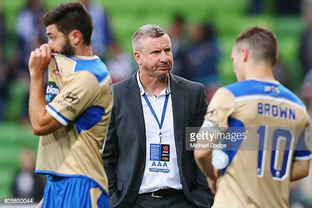 Jets head coach Mark Jones looks dejected after defeat during the round eight ALeague match between Melbourne Victory and the Newcastle Jets at AAMI...