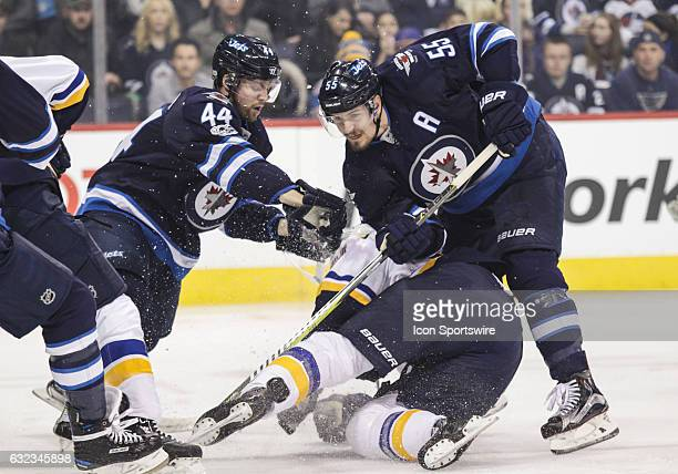 Jets Josh Morrissey and Mark Scheifele check Blues Jaden Schwartz during the NHL game between the Winnipeg Jets and the St Louis Blues on January 21...