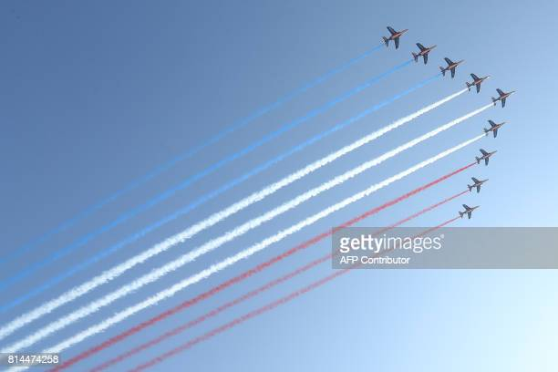 Jets of the Patrouille Acrobatique de France perform during a commemorative ceremony marking the first anniversary of a jihadist truck attack which...