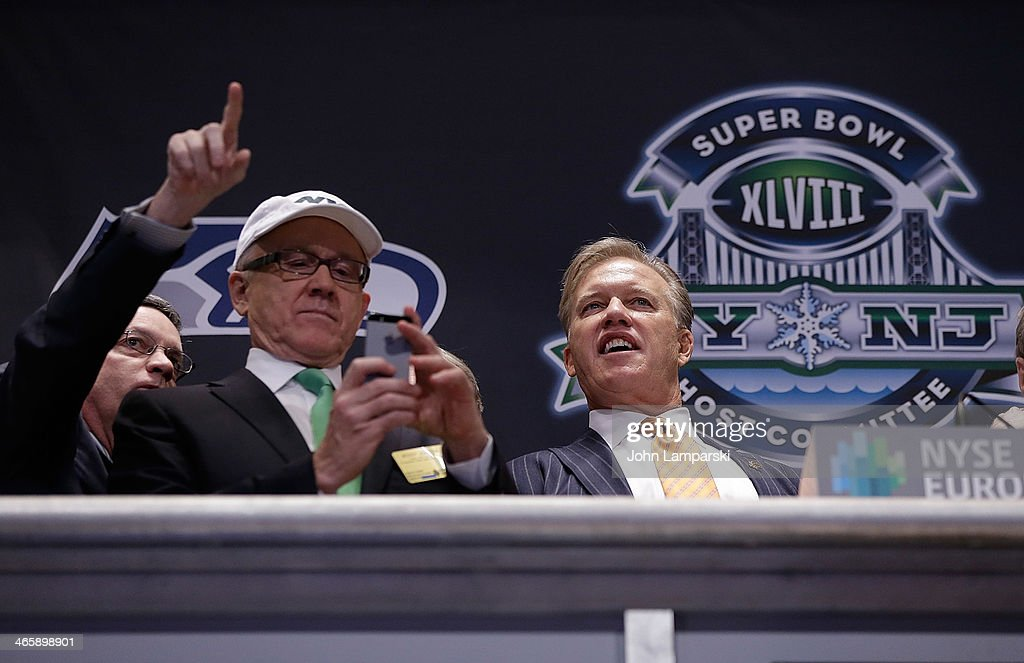 NY Jets Onwer Woody Johnson and Executiive VP of Football operatiohns, Denver Broncos, John Elway ring the opening bell at New York Stock Exchange on January 30, 2014 in New York City.