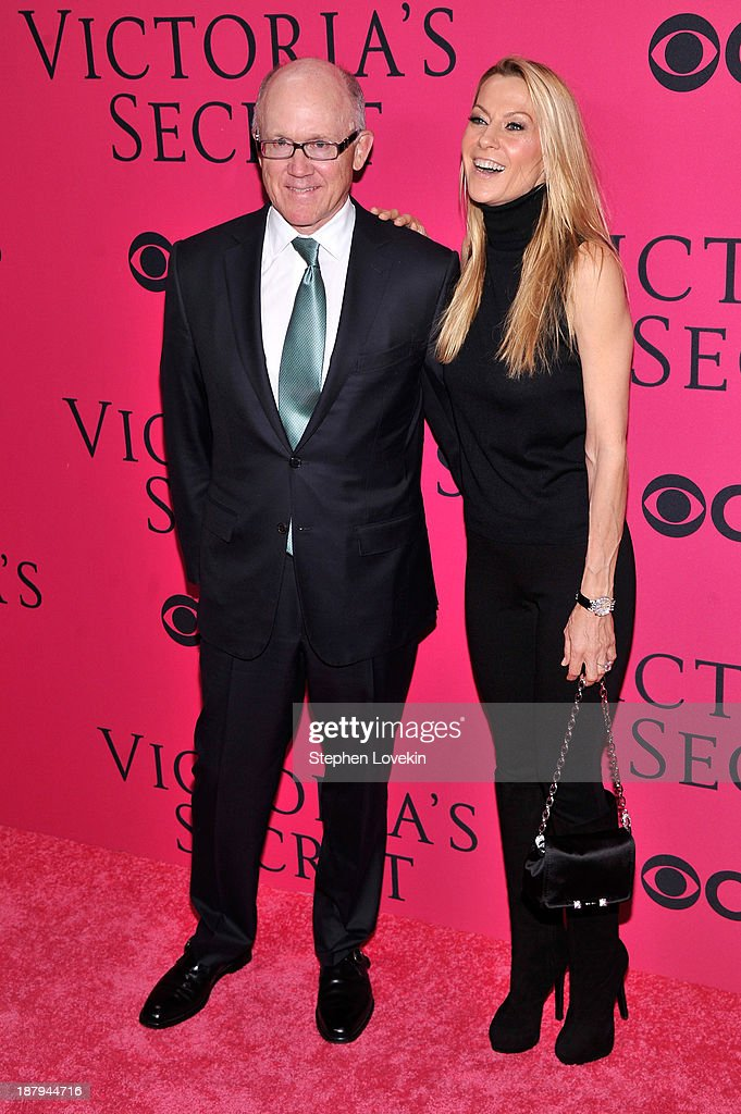 NY Jets owner <a gi-track='captionPersonalityLinkClicked' href=/galleries/search?phrase=Woody+Johnson&family=editorial&specificpeople=748966 ng-click='$event.stopPropagation()'>Woody Johnson</a> and Suzanne Johnson attend the 2013 Victoria's Secret Fashion Show at Lexington Avenue Armory on November 13, 2013 in New York City.