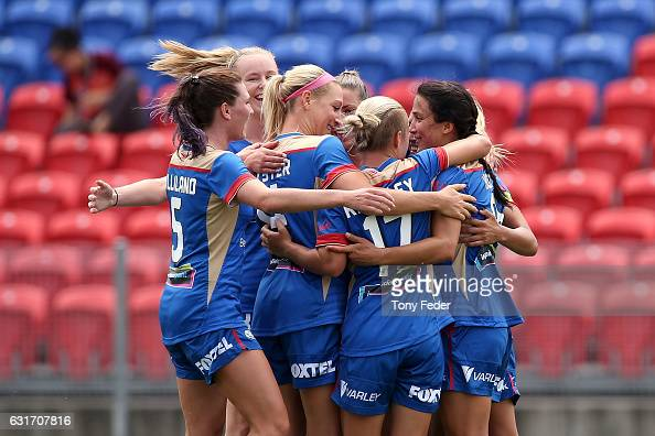 Jets players celebrate a goal by Jennifer Hoy during the round 12 WLeague match between the Newcastle Jets and the Brisbane Roar at McDonald Jones...
