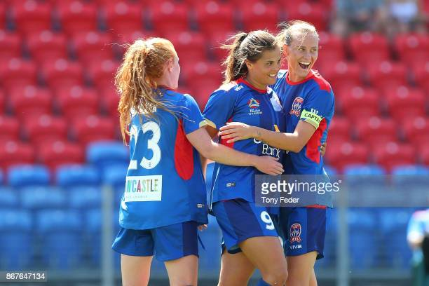 Jets players celebrate a goal during the round one WLeague match between the Newcastle Jets and the Western Sydney Wanderers at McDonald Jones...