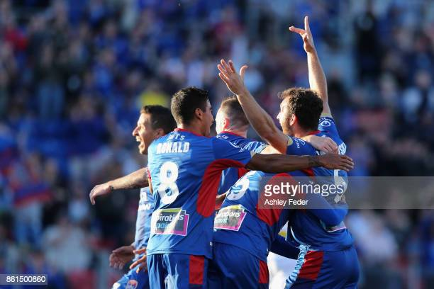 Jets players celebrate a goal from Benjamin Kantarovski during the round two ALeague match between the Newcastle Jets and Perth Glory at McDonald...