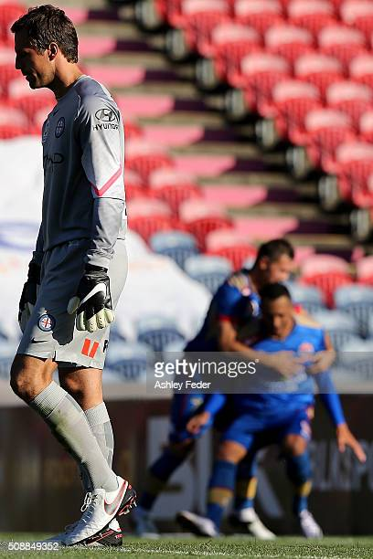 Jets players celebrate a goal in the background with Melbourne City goalkeeper Thomas Sorenson looking dejected in the foreground during the round 18...
