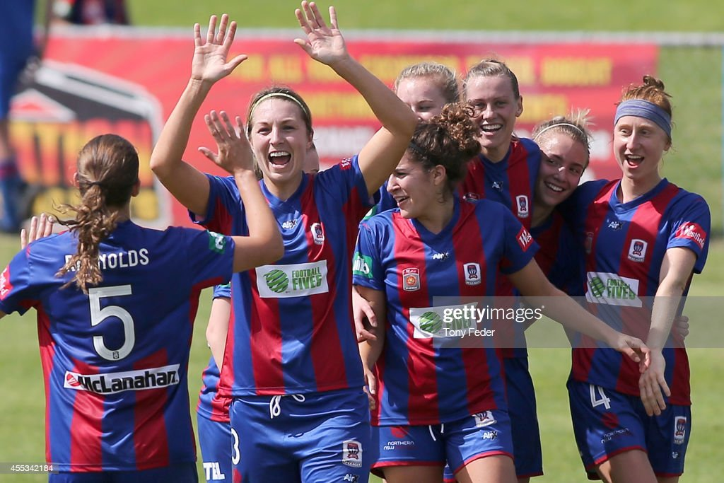 Jets players celebrate the win over Victory during the round one WLeague match between the Newcastle Jets and the Melbourne Victory at Magic Park on...
