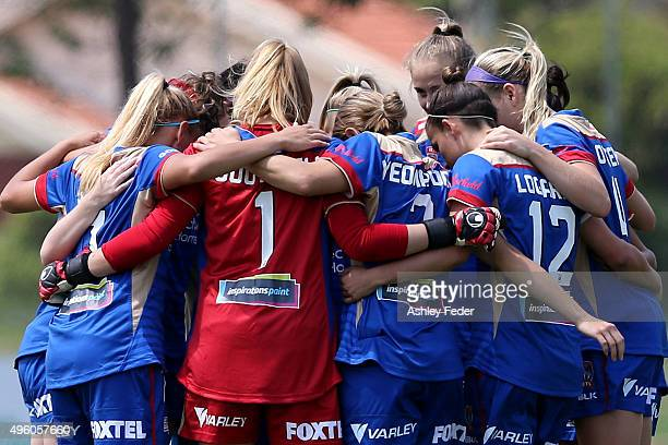 Jets players huddle during the round four WLeague match between the Newcastle Jets and the Western Sydney Wanderers at Magic Park on November 7 2015...