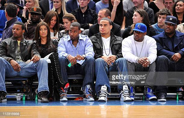 NY Jets players Kerry Rhodes with girlfriend Wallace Wright Dustin Keller Thomas Jones and Damien Woody attend the Los Angeles Lakers vs New York...