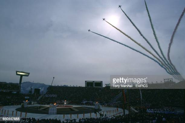 Jets spread out the colours of the Olympic rings in the sky to mark the ending of the Opening Ceremony of the Winter Olympics 1998 Minami Nagano...