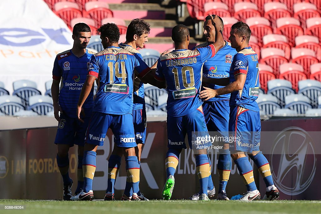 Jets team mates celebrate a goal during the round 18 A-League match between the Newcastle Jets and Melbourne City FC at Hunter Stadium on February 7, 2016 in Newcastle, Australia.