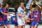 Jets teammates celebrate a goal during the round one WLeague match between the Newcastle Jets and the Melbourne Victory at Magic Park on September 13...