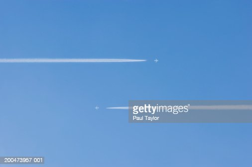 Jets vapour trails flying past each other (Digital Enhancement)