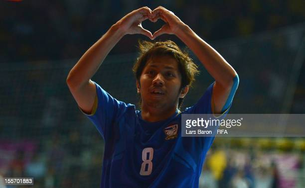 Jetsada Chudech of Thailand celebrates after scoring his teams second goal during the FIFA Futsal World Cup Group A match between Paraguay and...