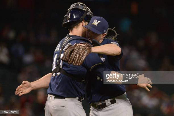 Jett Bandy and Corey Knebel of the Milwaukee Brewers celebrate after closing out the game against the Arizona Diamondbacks at Chase Field on June 9...