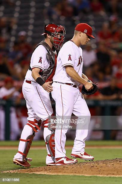 Jett Bandy talks with Andrew Bailey of the Los Angeles Angels of Anaheim after during the ninth inning of a game against the Oakland Athletics at...