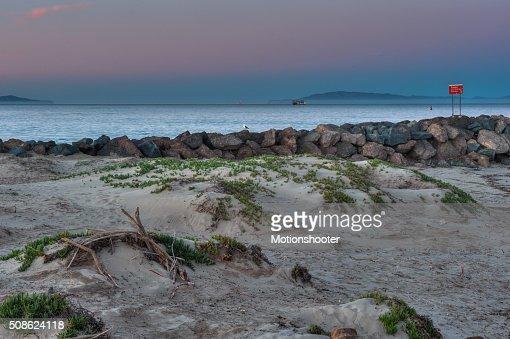 Jetty and sand dunes of the Ventura Harbor. : Stock Photo