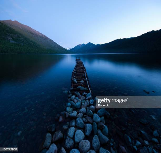 Jetty and stones on the shore of Multinskoe Lake