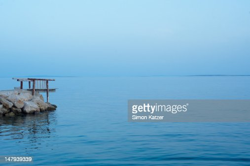 Jetty and the sea at the blue hour : Stock Photo