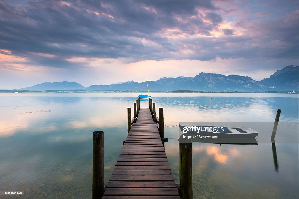 jetty at lake forggensee after a thunderstorm : Stock Photo